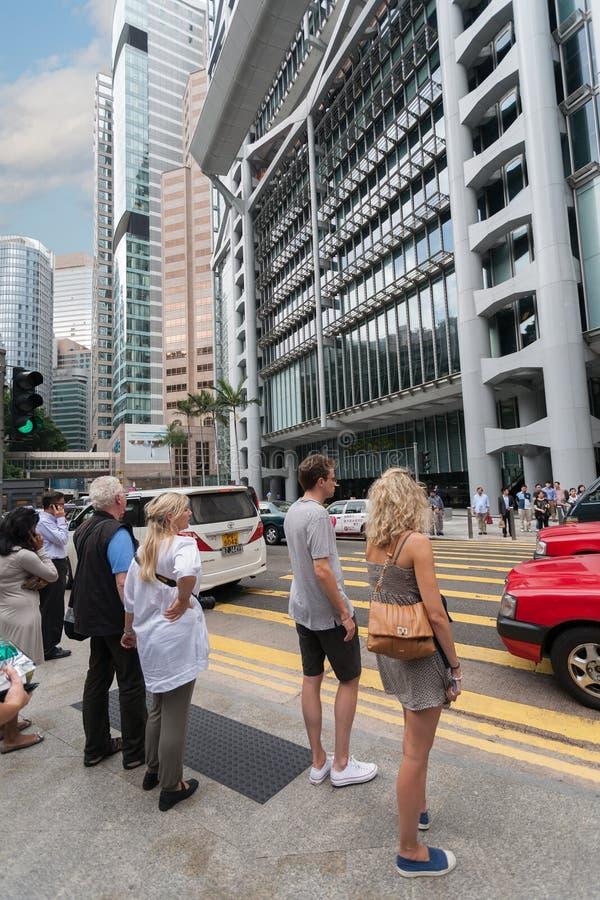 Amerikanska turister på en övergångsställe i Hong Kong royaltyfria foton