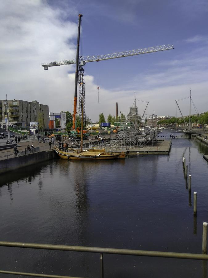 Amersfoort is getting ready for Kings Day. Building a pontoon. stock photography