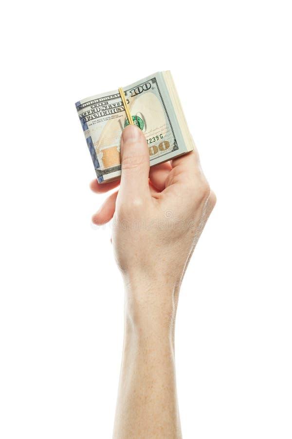 Amerykańscy dolary gotówkowego pieniądze w męskiej ręce odizolowywającej na białym tle Wiele 100 USA dolarów banknot obrazy royalty free