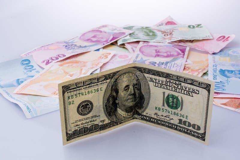 Amerykańscy dolarowi banknoty i Turksh lira banknoty popierają kogoś stronę - obok - obraz stock