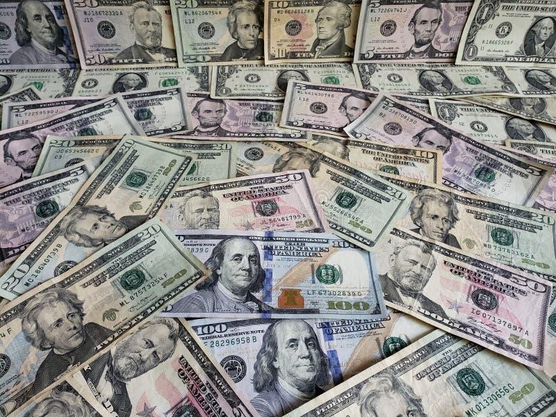 Amerykańscy dolary banknotów różni wyznania, tło i tekstura, fotografia stock