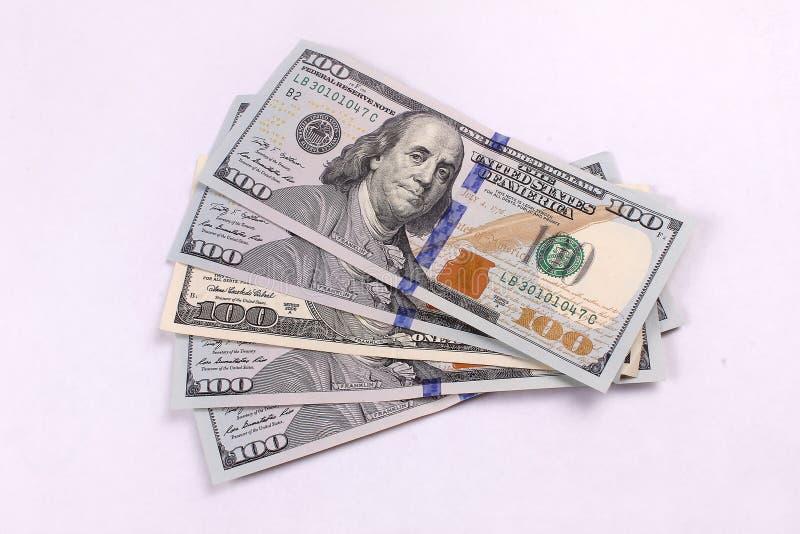 Amerykański pieniądze w 100 00 rachunków wypiętrzających wysoko obrazy stock