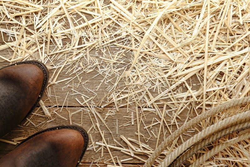 Amerykańskiego Zachodni Rodeo Kowbojscy Buty i Lasso na Drewnie zdjęcia stock