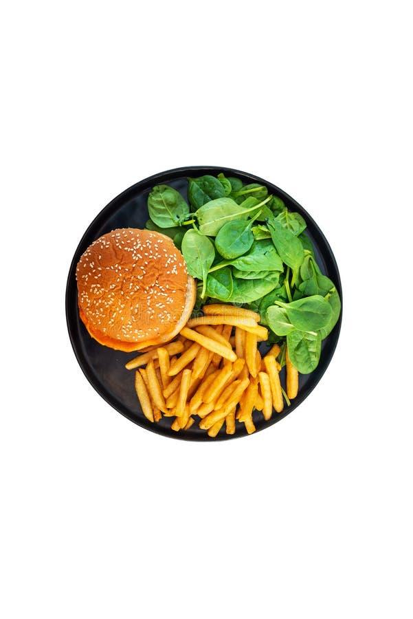 Ameryka?skiego sera hamburger z Z?otymi Francuskimi d?oniakami obraz royalty free