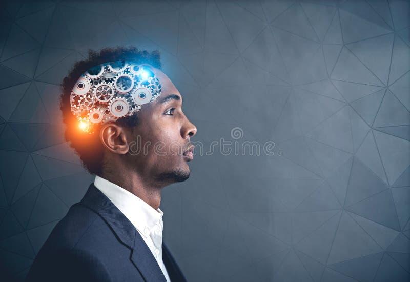 Amerykanin Afrykańskiego Pochodzenia biznesmen, cog mózg zdjęcia stock