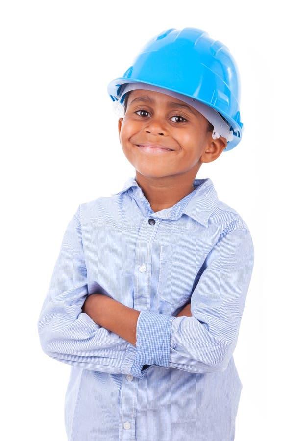 Amerykanin Afrykańskiego Pochodzenia chłopiec jest ubranym ochrona kapelusz - Czarny pe zdjęcie royalty free