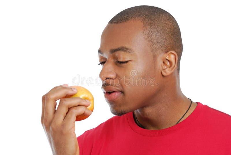 amerykanin afrykańskiego pochodzenia jabłczany łasowania mężczyzna obrazy stock