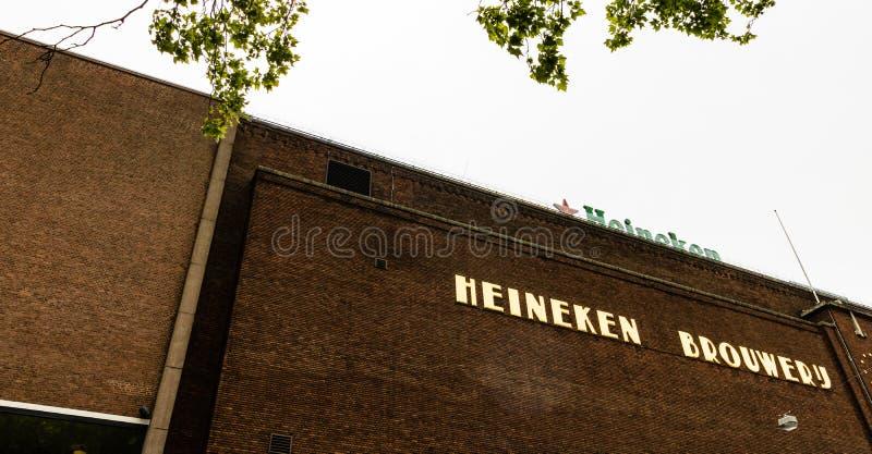 Amesterdam, Holland - 2019 Heineken Browery-byggnaden i Amsterdam royaltyfri foto