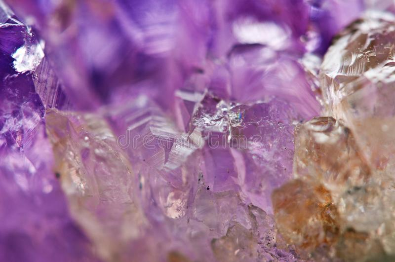 Amethyst natural mineral, beautiful abstract lilac Macro backgr. Ound. Natural light translucent crystal, extreme close-up stock photography