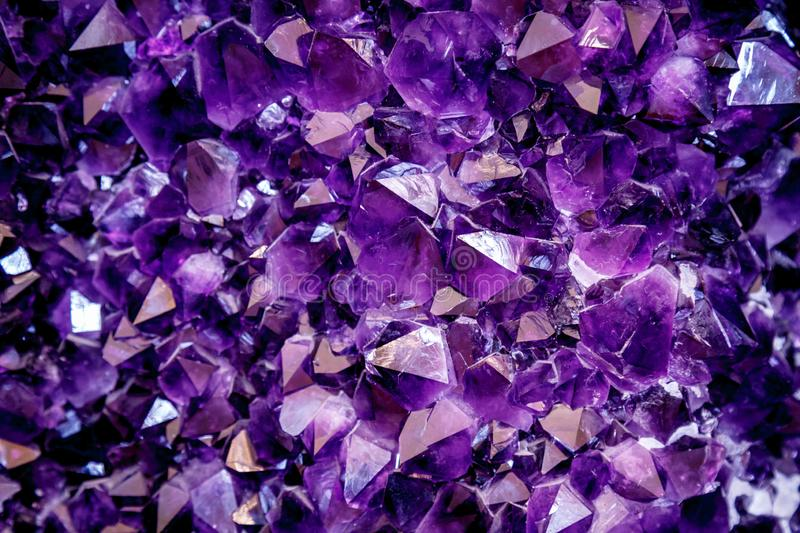 Amethyst purple crystal. Mineral crystals in the natural environment. Texture of precious and semiprecious gemstone. royalty free stock photo