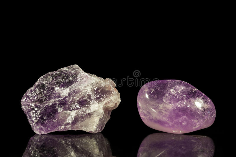 Amethyst, uncut and Tumble finishing. With black background and reflection stock photography