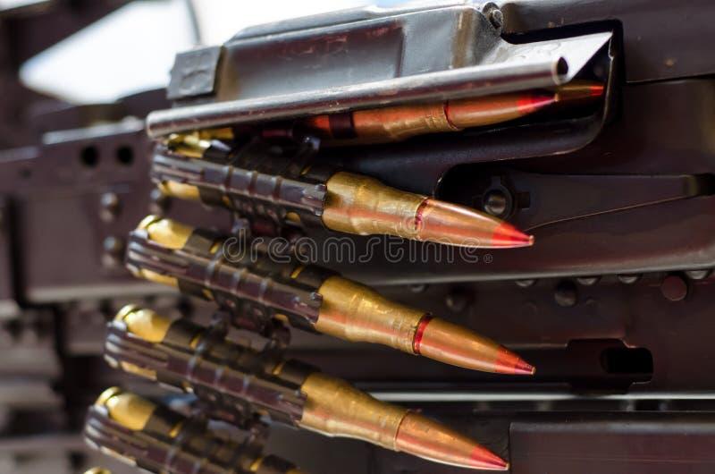 Ametralladora con la munición foto de archivo libre de regalías