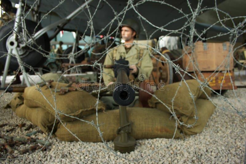 Ametralladora y soldado fotos de archivo libres de regalías