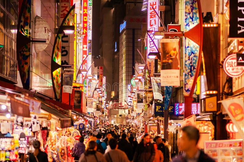 Ameyoko food street night life in Ueno district with tourists walking on street - Tokyo stock photography