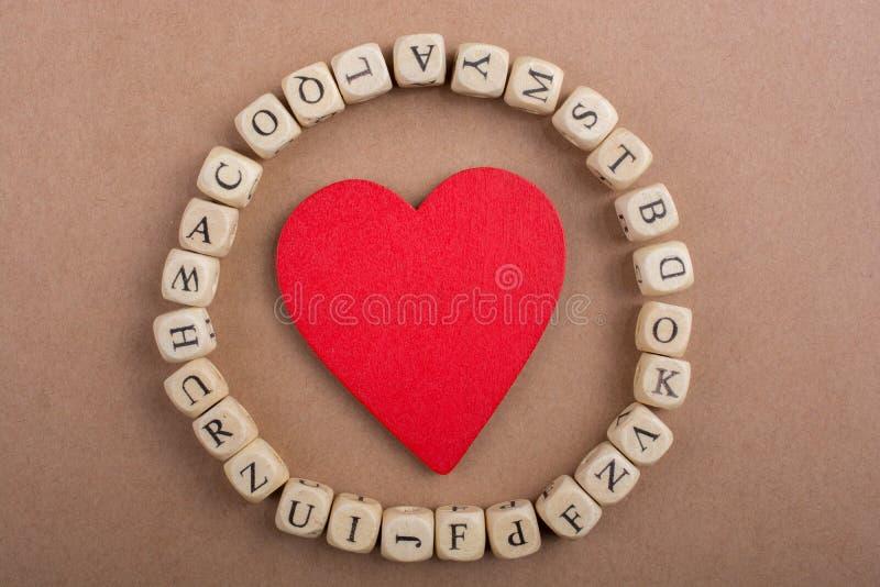 Ami l'icona e segni i cubi con lettere del fatto di di legno immagini stock libere da diritti