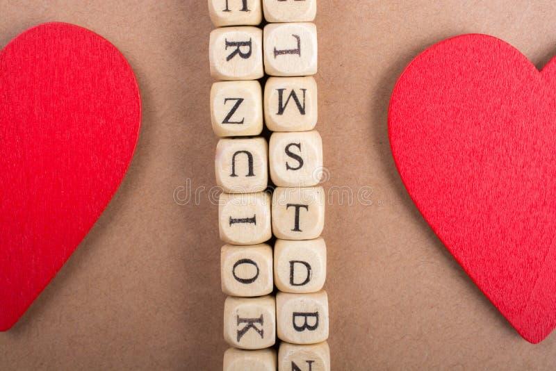 Ami l'icona e segni i cubi con lettere del fatto di di legno fotografie stock libere da diritti