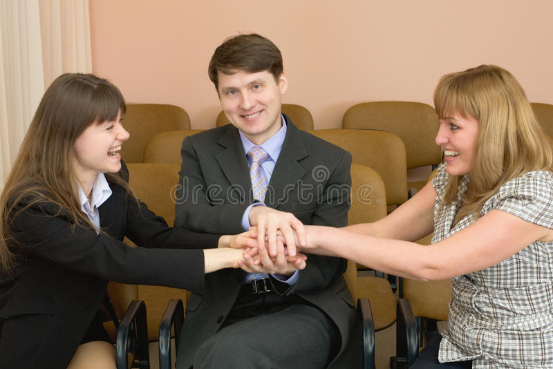 Amicable team of cheerful businessmen stock photos