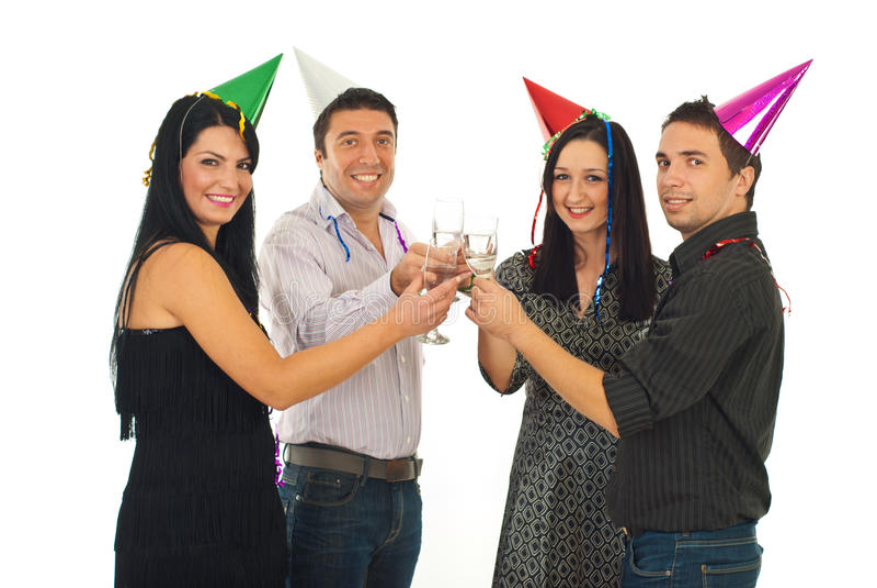 Amici che tostano al partito di notte di San Silvestro fotografia stock