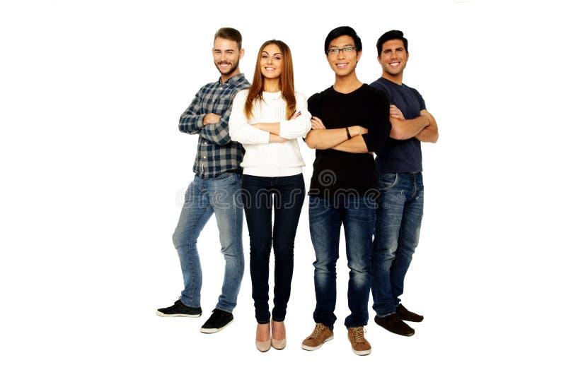 Amigos com posição dobrada braços junto imagens de stock royalty free