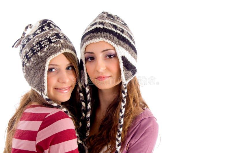 Amigos dos adolescentes que sorriem e que olham a câmera fotografia de stock