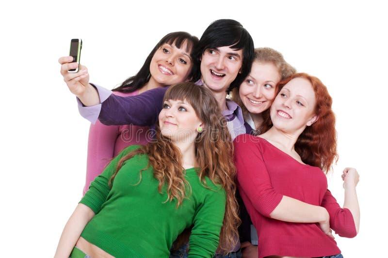 Amigos felizes que tomam o retrato no telefone imagem de stock