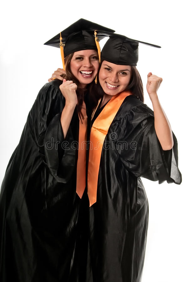 Amigos que comemoram a graduação imagens de stock