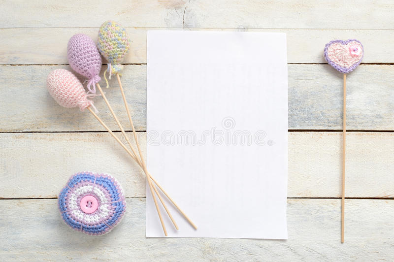 Amigurumi, Inspirational white card with some crochet handmade decoration. Inspirational white blank card with some crochet handmade decoration on a white wooden stock photos