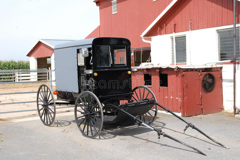 Amish Buggy. A traditional Amish buggy parked by a barn stock images