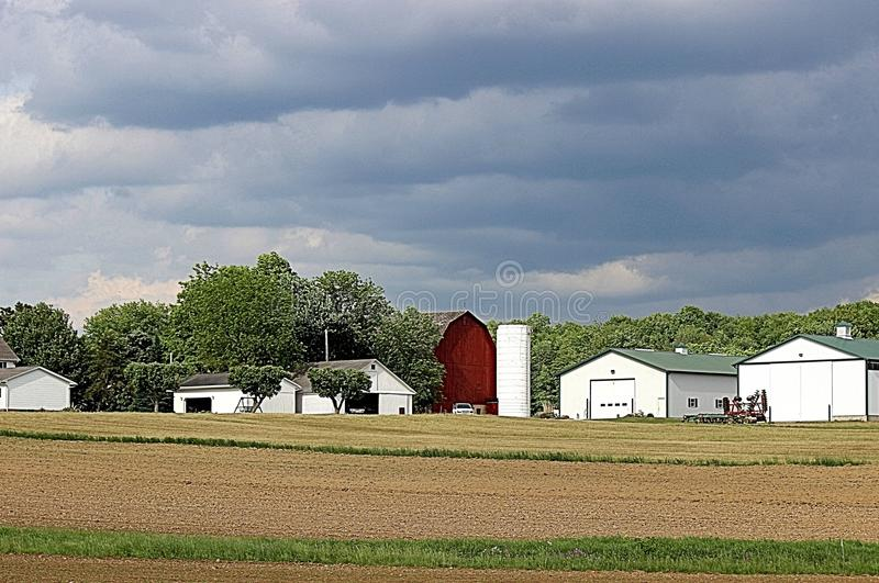 Amish Country Farm. It`s getting ready to rain stock images