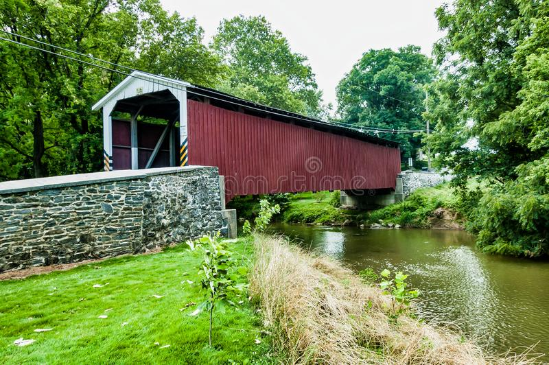 Amish Covered Bridge Buggy Going Through It. On a Summer Day royalty free stock photos
