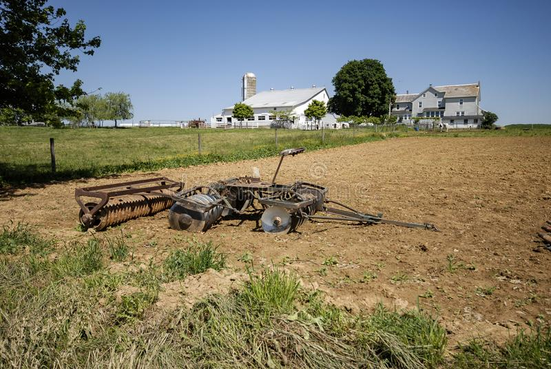 Amish Farm Equipment in Field. On a Sunny Summer Day stock photos