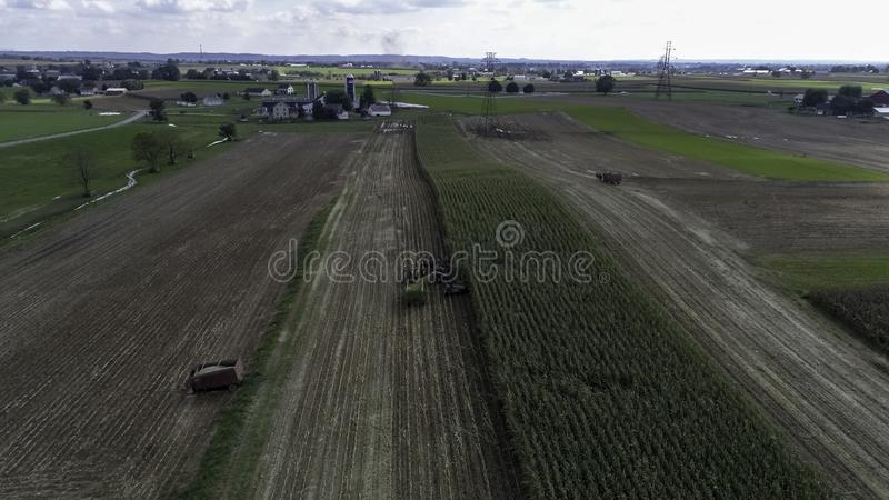Amish Farmers Harvesting Their Crops 2. Aerial View of Amish Farmers Harvesting Their Crops on an Autumn Day with Teams of Horses as Seen by a Drone royalty free stock photo