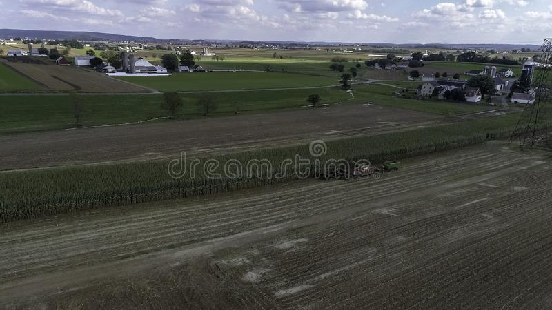 Amish Farmers Harvesting Their Crops 1. Aerial View of Amish Farmers Harvesting Their Crops on an Autumn Day with Teams of Horses as Seen by a Drone stock images