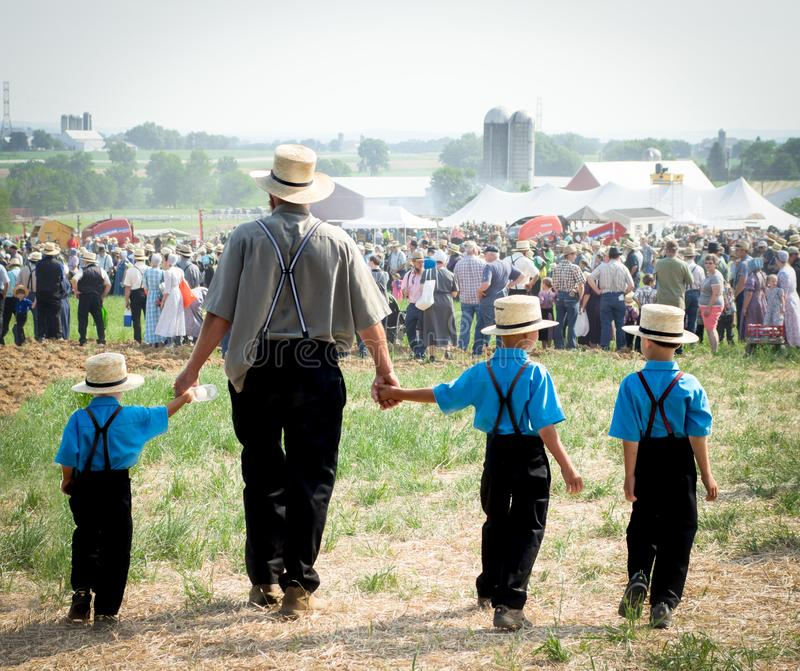 Amish Father and Sons. LEOLA, PA - JUNE 30, 2017: Amish fathers walks his three sons to view the Horse Progress Days  activities in Leola, Pensylvania on June 30 royalty free stock images