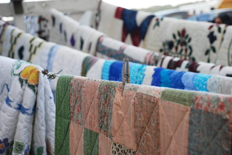 Amish handmade quilts hanging on line stock photography
