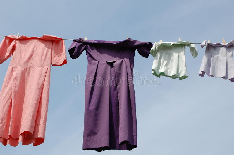 Amish Laundry. A washing line with traditional Almish dresses drying in the air. This is a common sight in the farm area around Lancaster, Pennsylvania, where stock images