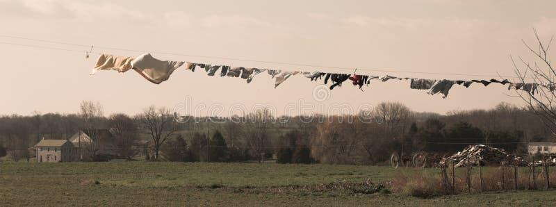 Amish laundry and farm. Laundry waving in the breeze on an amish farm, pennsylvania dutch country, sepia royalty free stock photos