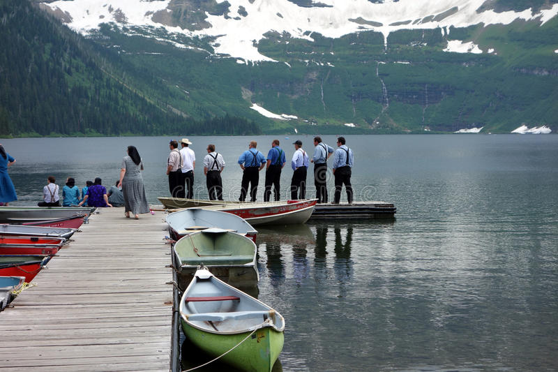 Amish men admiring a mountain in alberta stock photo