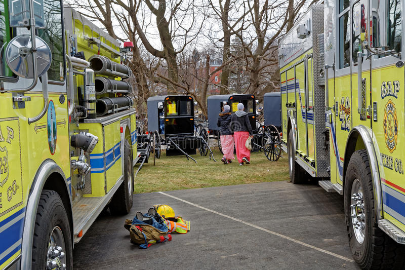 Amish Mud Sale in Lancaster County. GAP PENNSYLVANIA - MARCH 25, 2017: Fire Engines and Amish Carriages parked side by side at the Annual `Amish Mud Sale` which stock photography