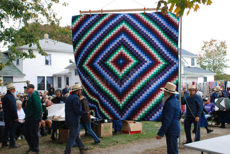 Amish Quilt Auction hanging from a tree stock image