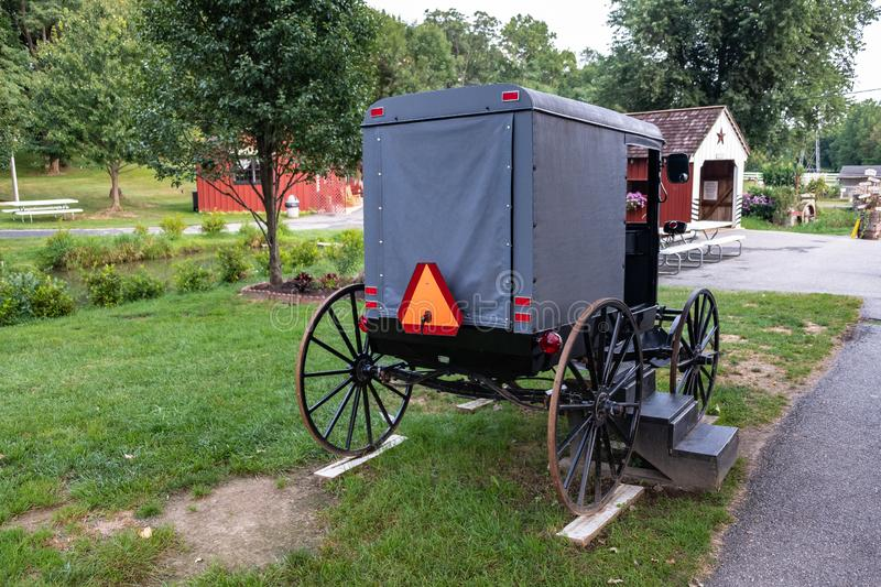 Amish Village and buggy, Pennsylvania. Amish Village in Amish country, Pennsylvania, united states of america. This is the typical amish mean of transportation royalty free stock image