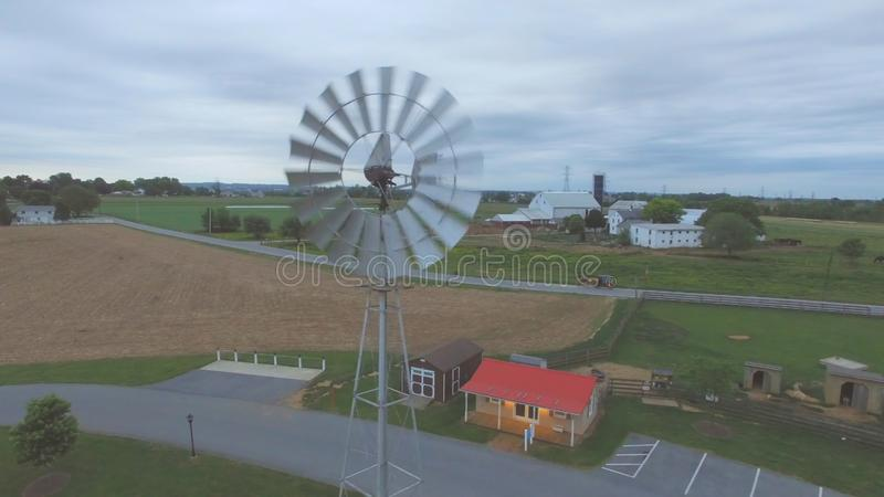 Amish Windmill as seen by a Drone. Aerial View of an Amish Windmill as Seen by a Drone on a Cloudy Spring Day stock images