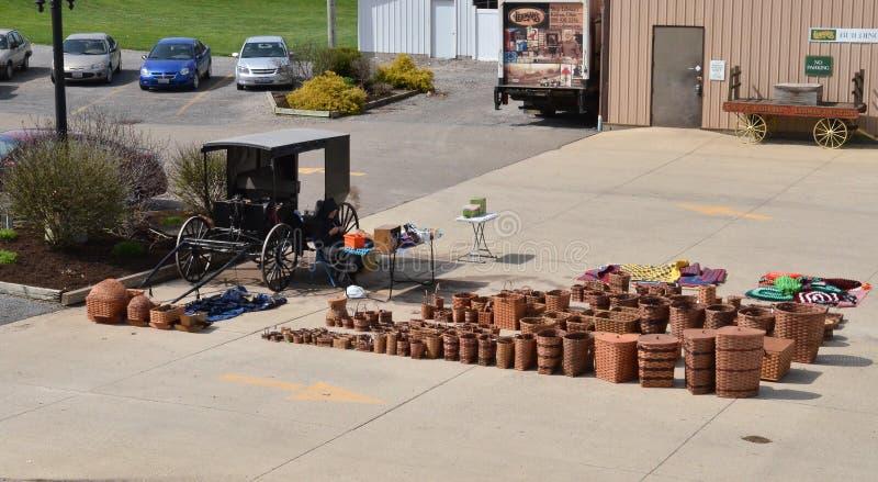 Amish woman selling baskets. stock photo