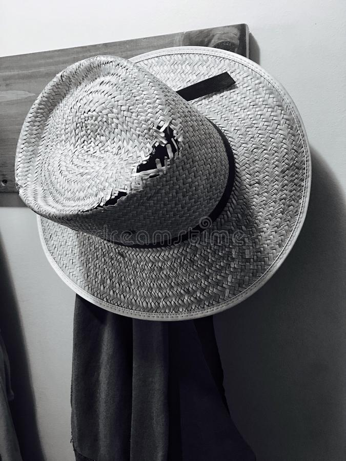 Amish work hat. Straw hat worn by Amish hung on a rack royalty free stock photos