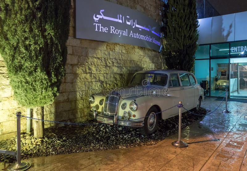 Old white Jaguar stands at the entrance of the King Abdullah II car museum in Amman, the capital of Jordan. Amman, Jordan, December 07, 2018 : Old white Jaguar stock image