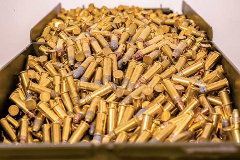 Large ammo box full of bullets. Ammo box full of bullets shot with a macro lens royalty free stock photos