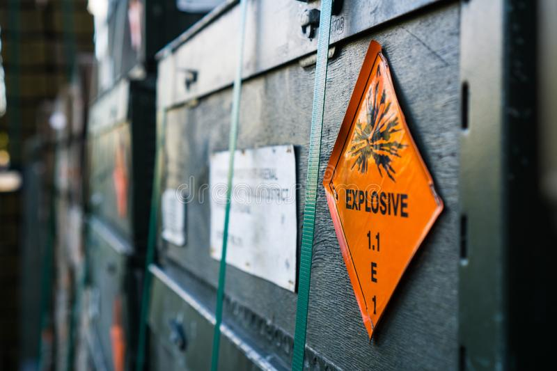 Explosive, warning warning signs on the side of a crate. Ammunition Crates Explosive in an ammunition holding area stock image
