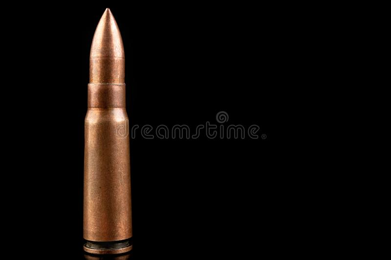 Ammunition of a high-speed rifle. Cartridges for a military rifle. Dark background, ammo, armed, army, battle, black, brass, bullet, bullets, caliber, closeup stock photos