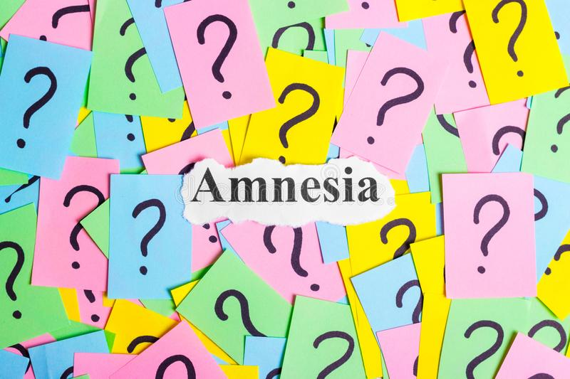 Amnesia Syndrome text on colorful sticky notes Against the background of question marks.  royalty free stock images