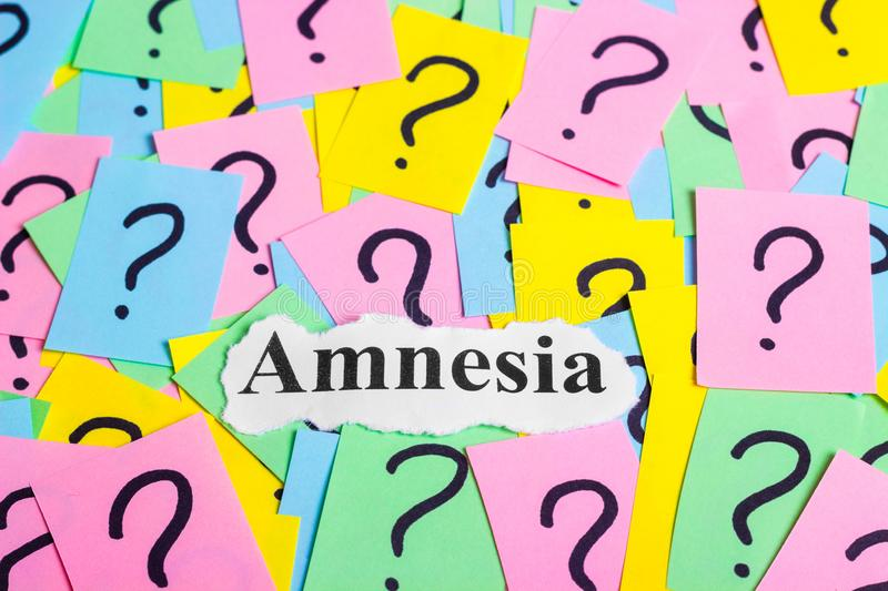 Amnesia Syndrome text on colorful sticky notes Against the background of question marks.  royalty free stock image